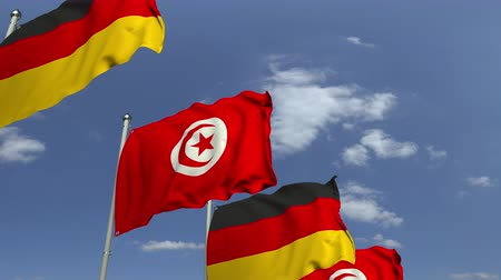 tunus : Many flags of Tunisia and Germany, loopable 3D animation
