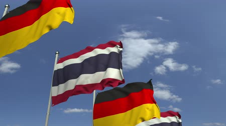 onderhandeling : Flags of Thailand and Germany against blue sky, loopable 3D animation