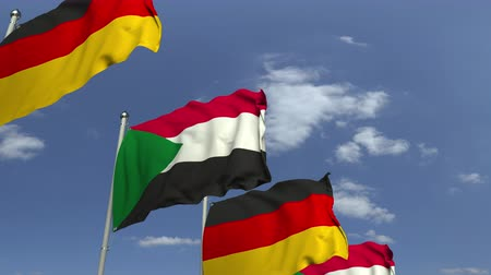 meeting negotiate : Waving flags of Sudan and Germany on sky background, loopable 3D animation