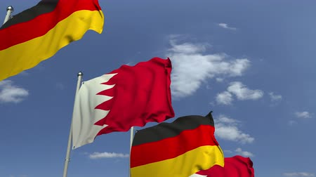 zahraniční : Row of waving flags of Bahrain and Germany, loopable 3D animation