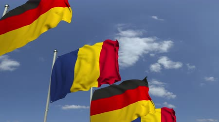 meeting negotiate : Flags of Romania and Germany at international meeting, loopable 3D animation