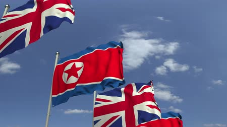 şaft : Waving flags of North Korea and the United Kingdom, loopable 3D animation Stok Video