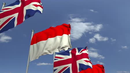 샤프트 : Flags of Indonesia and the United Kingdom against blue sky, loopable 3D animation 무비클립