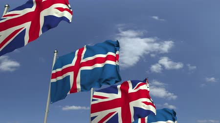onderhandeling : Waving flags of Iceland and the United Kingdom, loopable 3D animation Stockvideo