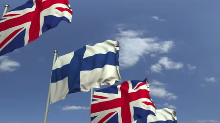 fince : Row of waving flags of Finland and the United Kingdom, loopable 3D animation Stok Video