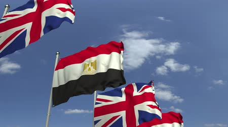 onderhandeling : Flags of Egypt and the United Kingdom against blue sky, loopable 3D animation Stockvideo