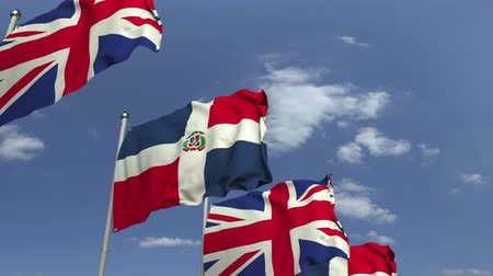 konferans : Flags of the Dominican Republic and the United Kingdom at international meeting, loopable 3D animation Stok Video