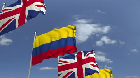 colômbia : Flags of Colombia and the United Kingdom against blue sky, loopable 3D animation