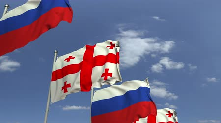şaft : Row of waving flags of Georgia and Russia, loopable 3D animation Stok Video