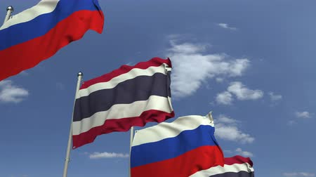 meeting negotiate : Flags of Thailand and Russia against blue sky, loopable 3D animation
