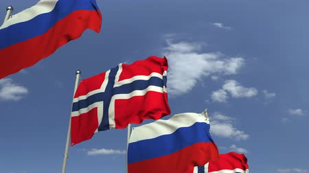 şaft : Flags of Norway and Russia at international meeting, loopable 3D animation Stok Video