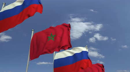 марокканский : Waving flags of Morocco and Russia on sky background, loopable 3D animation
