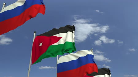 konferans : Waving flags of Jordan and Russia on sky background, loopable 3D animation Stok Video
