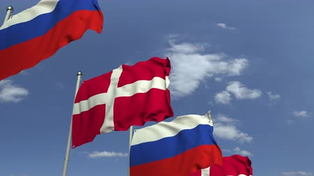 デンマーク語 : Waving flags of Denmark and Russia on sky background, loopable 3D animation