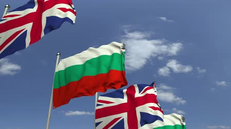 búlgaro : Flags of Bulgaria and the United Kingdom against blue sky, loopable 3D animation