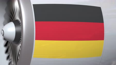 moscas : Airplane turbine with flag of Germany. German transportation conceptual 3D animation Stock Footage