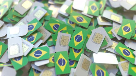 gsm : Pile of SIM cards with flag of Brazil. Brazilian mobile telecommunications related conceptual 3D animation Stock Footage