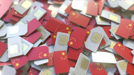 gsm : Pile of SIM cards with flag of China. Chinese mobile telecommunications related conceptual 3D animation