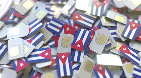 gsm : Multiple SIM cards with flag of Cuba. Cuban mobile telecommunications conceptual 3D animation