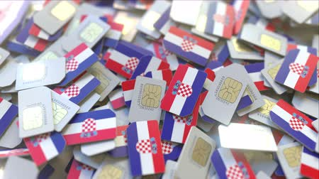 telekomünikasyon : Multiple SIM cards with flag of Croatia. Croatian mobile telecommunications conceptual 3D animation