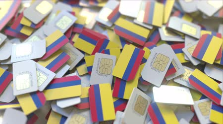 gsm : Pile of SIM cards with flag of Colombia. Colombian mobile telecommunications related conceptual 3D animation Stock Footage