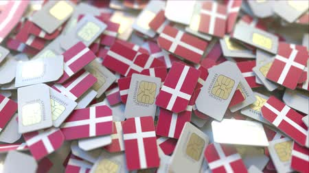 abbonamento : SIM cards with flag of Denmark. Danish cellular network related conceptual 3D animation Filmati Stock