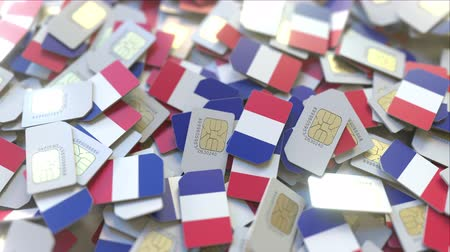 dekking : Pile of SIM cards with flag of France. French mobile telecommunications related conceptual 3D animation Stockvideo
