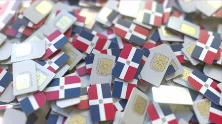 abbonamento : Pile of SIM cards with flag of Dominican Republic. Dominicana mobile telecommunications related conceptual 3D animation Filmati Stock