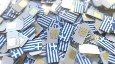 gsm : Multiple SIM cards with flag of Greece. Greek mobile telecommunications conceptual 3D animation
