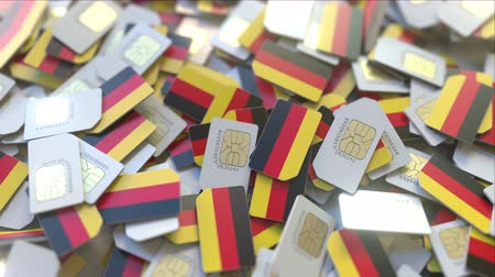 abbonamento : SIM cards with flag of Germany. German cellular network related conceptual 3D animation