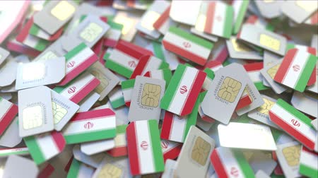 abbonamento : Multiple SIM cards with flag of Iran. Iranian mobile telecommunications conceptual 3D animation