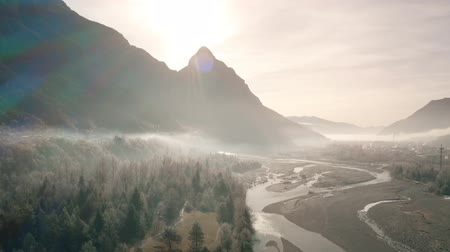montanhas rochosas : Aerial shot of beautiful misty river valley in the Alps in northeastern Italy Stock Footage