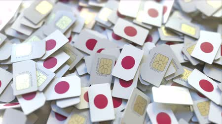 abbonamento : Multiple SIM cards with flag of Japan. Japanese mobile telecommunications conceptual 3D animation Filmati Stock