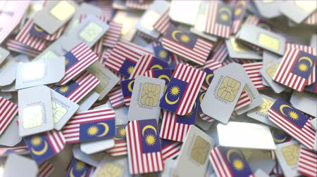 gsm : SIM cards with flag of Malaysia. Malaysian cellular network related conceptual 3D animation Stock Footage