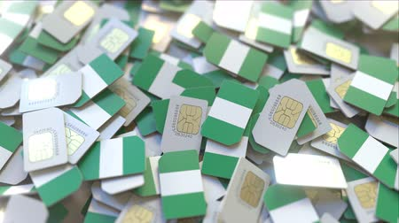 nigeria flag : Many SIM cards with flag of Nigeria, Nigerian mobile telecommunications related 3D animation