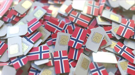 abbonamento : SIM cards with flag of Norway. Norwegian cellular network related conceptual 3D animation Filmati Stock