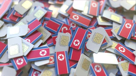 gsm : SIM cards with flag of North Korea. Korean cellular network related conceptual 3D animation