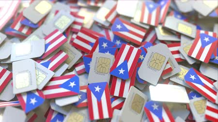 gsm : SIM cards with flag of Puerto Rico. Puerto Rican cellular network related conceptual 3D animation Stock Footage