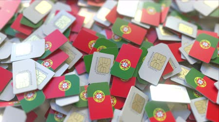 abbonamento : Pile of SIM cards with flag of Portugal. Portuguese mobile telecommunications related conceptual 3D animation Filmati Stock