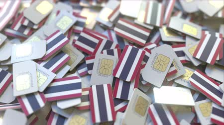 abbonamento : Many SIM cards with flag of Thailand, Thai mobile telecommunications related 3D animation Filmati Stock