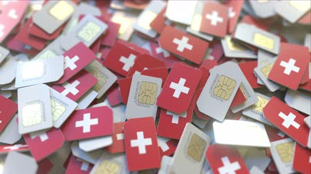 abbonamento : SIM cards with flag of Switzerland. Swiss cellular network related conceptual 3D animation