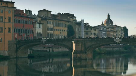 arno : A bridge and old riverfront buildings in Florence, Italy