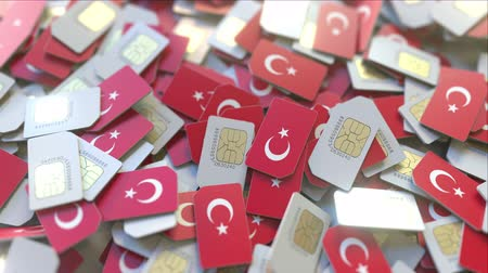 gsm : Multiple SIM cards with flag of Turkey. Turkish mobile telecommunications conceptual 3D animation Stock Footage