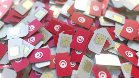 abbonamento : SIM cards with flag of Tunisia. Tunisian cellular network related conceptual 3D animation Filmati Stock