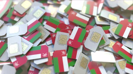 abbonamento : Multiple SIM cards with flag of Oman. Omani mobile telecommunications conceptual 3D animation