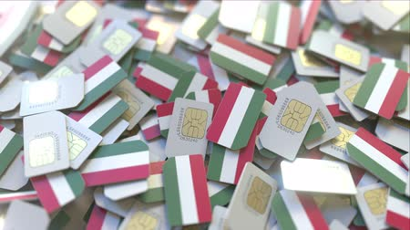 abbonamento : Multiple SIM cards with flag of Hungary. Hungarian mobile telecommunications conceptual 3D animation