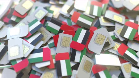 subscriber : Many SIM cards with flag of the United Arab Emirates, the UAE mobile telecommunications related 3D animation