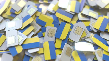 usuário : Pile of SIM cards with flag of Ukraine. Ukrainian mobile telecommunications related conceptual 3D animation