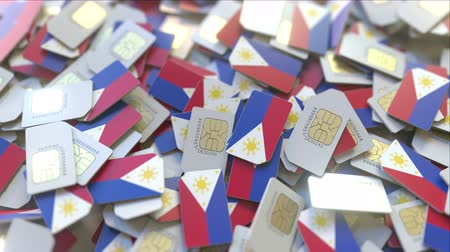 gsm : SIM cards with flag of the Philippines. Filipino cellular network related conceptual 3D animation Stock Footage