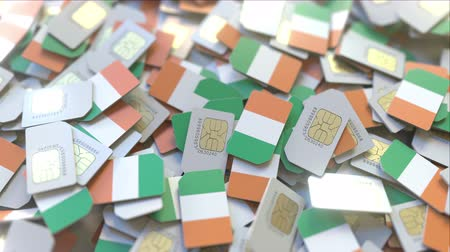 subscriber : Many SIM cards with flag of Ireland, Irish mobile telecommunications related 3D animation Stock Footage